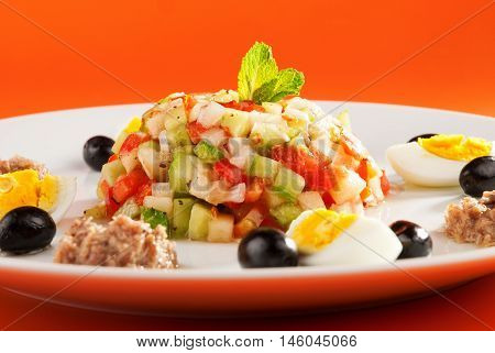 Tunisian salad with cucumbers tuna fish eggs and olives. Horizontal shot