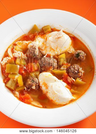 Tunisian soup with meatballs and eggs. Shot from above vertical view