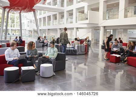 Students socialising in the lobby of modern university