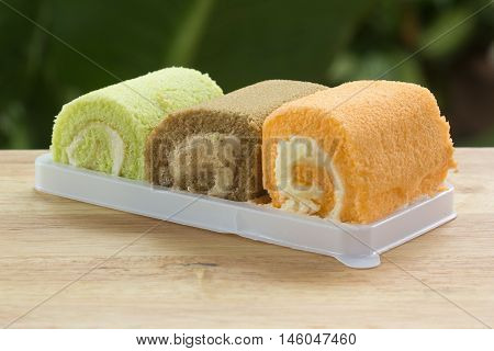 Three flavors jam rool cake on the tray