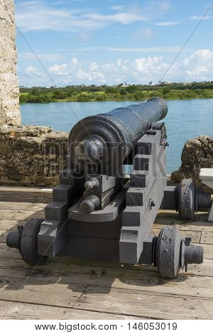 Historic antique black iron Spanish war fort defense canon used to defend fort from pirates and invaders