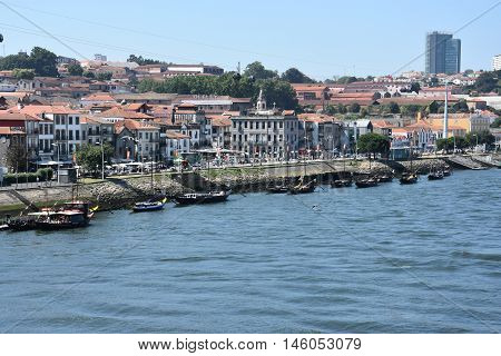 PORTO, PORTUGAL - AUG 22: Vila Nova de Gaia in Porto, on the river Douro, in Portugal, as seen on Aug 22, 2016. Porto is the second largest city in Portugal after Lisbon.
