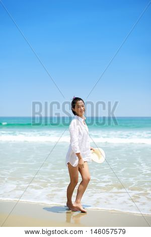 Asian Girl Walking On The Beach