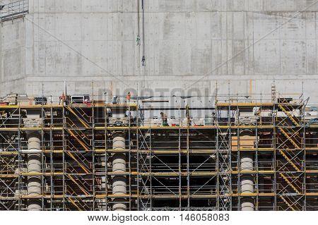 Construcion Workes On Scaffolding Rebuilding Facade