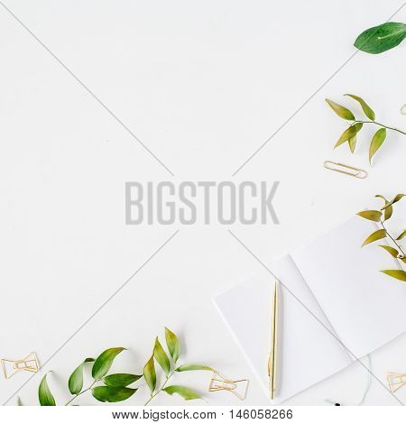 feminine home office workspace mockup with branches golden pen clips. flat lay top view
