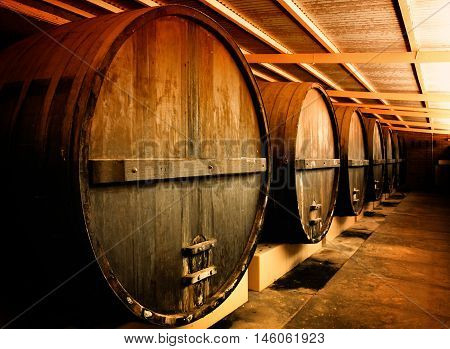 Large wooden Barrels at a Winery. Winery.