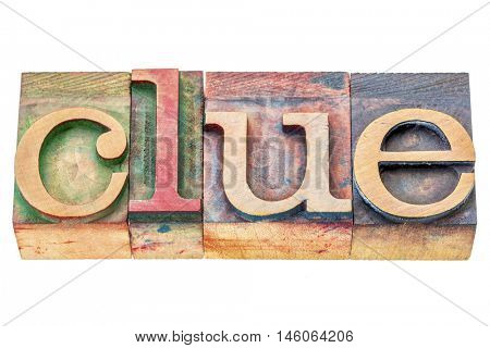 clue  - isolated word abstract in letterpress wood type printing blocks stained by color inks