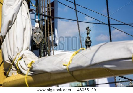 Christopher Columbus statue is one of the iconic images of Barcelona. A view throug the rigging of a Sailing Ship. Suitable for Columbus day, World Oceans, European Maritime or World Maritime Day