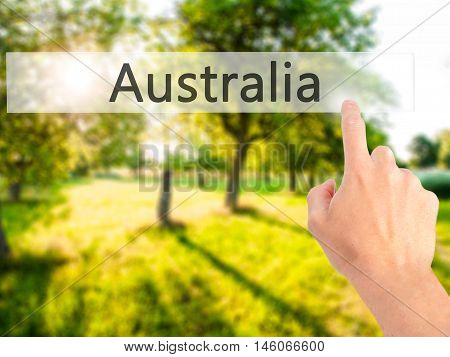 Australia - Hand Pressing A Button On Blurred Background Concept On Visual Screen.