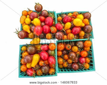 Four baskets of ripe multi colored cherry tomatoes