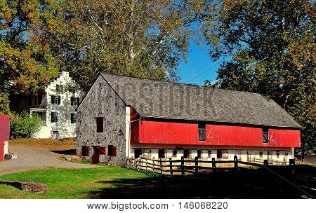 Hopewell Furnace Pennsylvania - October 15 2015: The stone and red barn for draft animals and 1770-1800 Ironmaster's Mansion  *