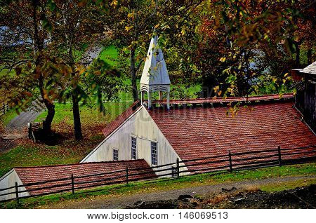 Hopewell Furnace Pennsylvania - October 15 2015: The Cast House with its distinctive wooden roof cupola at Hopewell Furnace National Histotric Site
