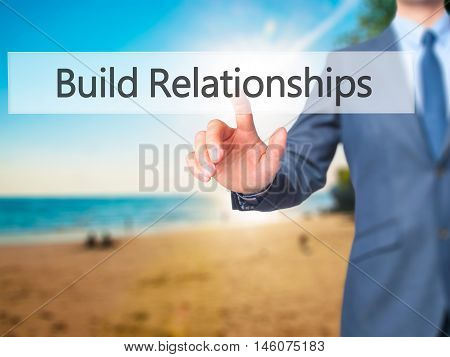 Build Relationships - Businessman Hand Pressing Button On Touch Screen Interface.