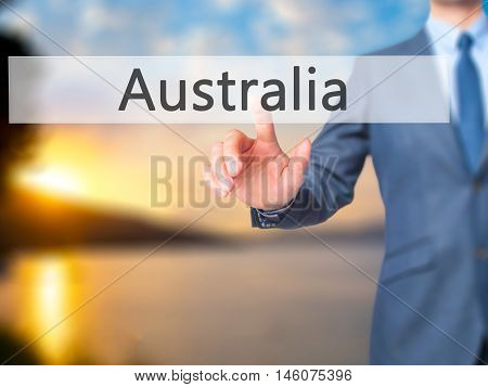 Australia - Businessman Hand Pressing Button On Touch Screen Interface.