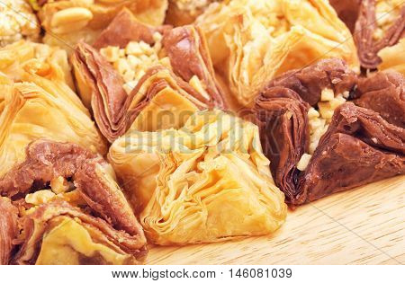 different oriental sweets baklava on wooden table