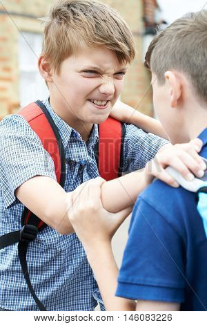 Two Young Boys Fighting In School Playground