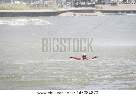 JERSEY CITY NJ MAY 29 2016: U.S. Coast Guard rescue swimmer floats in the water while performing a Search and Rescue demonstration at Liberty State Park at Fleet Week 2016.