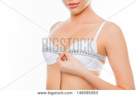 Close Up Of Young Woman Measuring Size Of Her Jugs