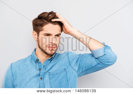Portrait Of Handsome Stylish Young Man Touching His Hair