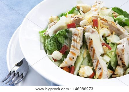 Chicken Caesar salad with romaine lettuce, croutons, grated parmesan, bacon bits, and grilled chicken breast. Delicious!