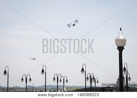 JERSEY CITY NJ MAY 29 2016: A U.S. Marine Corps MV-22 Osprey tiltrotor aircraft flies past Liberty State Park along the Hudson River towards the Upper New York Bay during Fleet Week NY 2016.