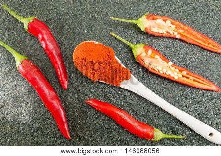 Red Hot  Peppers On Stone Background