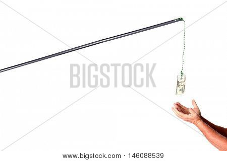 Money on a stick or pursuit of money just out of reach. A man grabs money just out of reach on a stick and string from the sky.