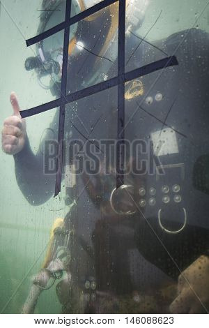 JERSEY CITY NJ MAY 29 2016: A US Navy EOD technician gives the thumbs up signal from inside the 6,800 gallon mobile dive tank during Fleet Week NY 2016 in Liberty State Park.