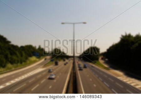 BEACONSFIELD ENGLAND - JUNE 2016: Busy M40 motorway at the Beaconsfield turn off Out of focus.