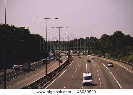 BEACONSFIELD ENGLAND - JUNE 2016: Busy M40 motorway at the Beaconsfield turn off Vintage Retro Filter.