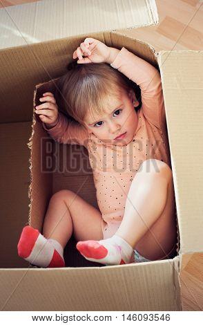 Baby Toddler In A Carton Box