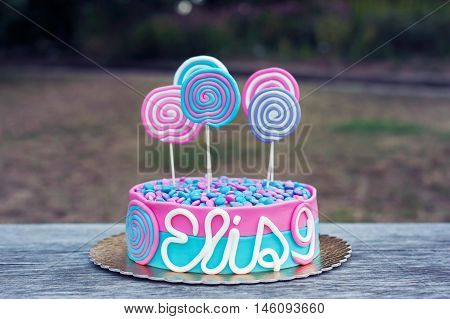 Delicious birthday cake on a table outdoor