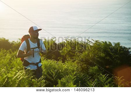 Backpaker Hiking On Hills Near Sea