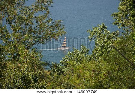 Gabicce Mare (RN) Italy - August 29 2016: Tourist boat sailing on the Adriatic Coast in summer
