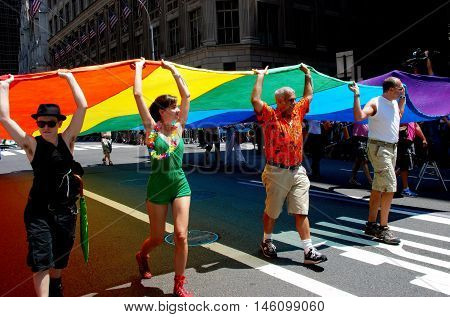 New York City - June 30 2007: Marchers carrying a giant rainbow flag at the 2007 Gay Pride Parade on Fifth Avenue