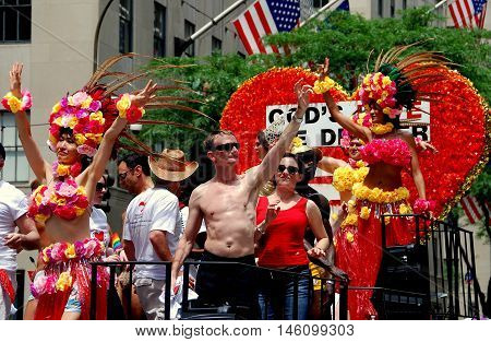 New York City - June 30 2007: Riders in colourful costumes on the God's Love We Deliver float at the 2007 Gay Pride Parade on Fifth Avenue