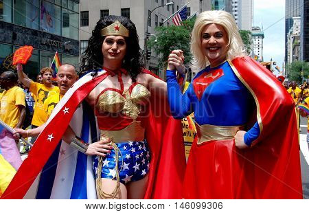 New York City - June 30 2007: Wonder Woman and Supergirl put in an appearance at the 2007 Gay Pride Parade on Fifth Avenue