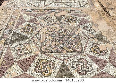 PAPHOS, CYPRUS - MARCH 11: Ancient mosaics at the Archaeological Helenistic and Roman site at Kato Paphos in Cyprus on 11 March, 2016.