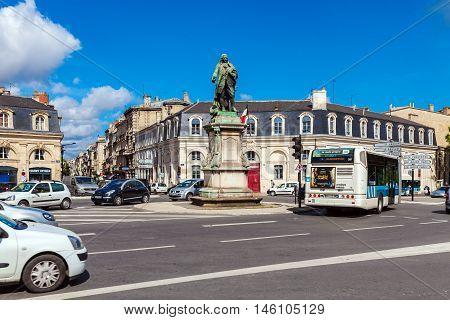 Bordeaux, France - April 4, 2011: Automotive Traffic Near Statue Of  Marquis De Tourny