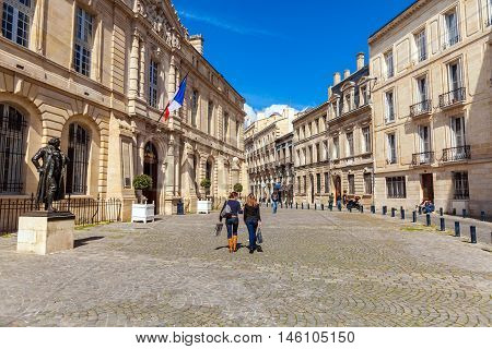 Bordeaux, France - April 4, 2011: Two French Girls Walking In Front Of Francisco De Goya Statue