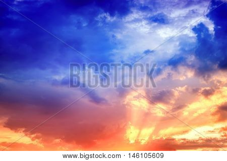Dramatic and moody sunset with dark cloudy sky. Abstract nature background