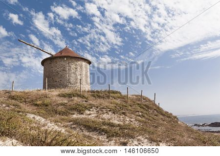 Ancient windmill in the top of a dune, Esposende, Portugal