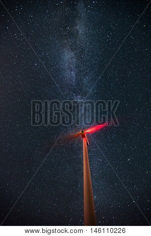 Wind Turbines On The Starry Night Sky With Milkyway