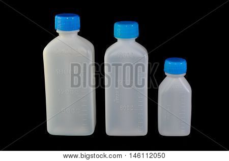 Three different size of plastic bottles with scale for liquid medicine, 240 CC, 180 CC and 60 CC