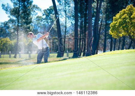 Golfer Playing A Chip Shot Onto The Green