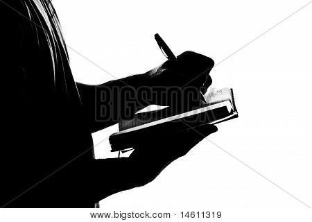Silhouette Of Man Writing Business Diary