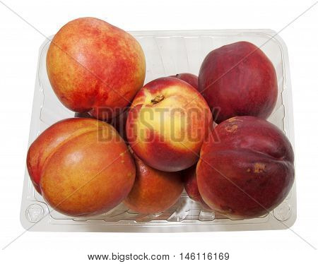 Open Basket with fresh organic Nectarines on the market for sale