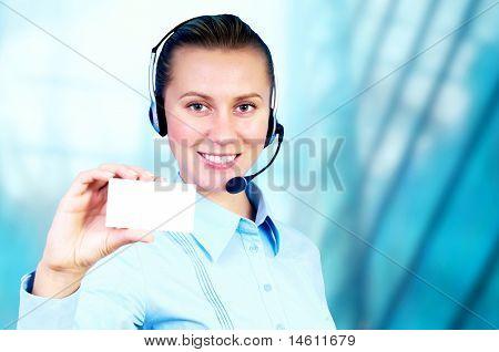 Happiness businesswoman speak in headphones on blur business architecture background