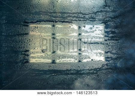 Closeup of water condensation on transparent glass surface