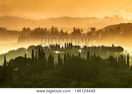 Tuscany Village Landscape On A Hazy Morning In July